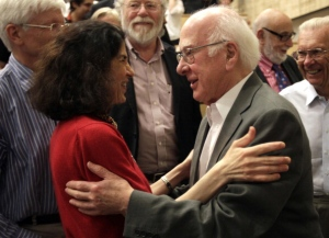 British physicist Peter Higgs (R) congra